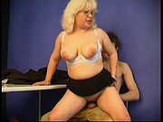 Guy-pupil & plump teacher woman at the lesson
