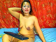 MATURE THAI LADY SHOWING HER BIG BOOBS ON CAM