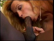Blonde mature sucks a big black cock