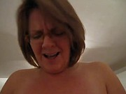 Mature woman's face while cumming