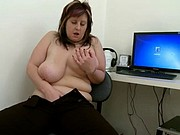 Mom playing with her plump cunt at office