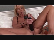 MILF Tries Out Huge Toys In Her Cunt
