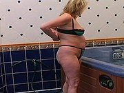 Blonde plump milf in bath